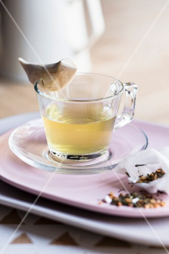 Genmaicha tea in a glass cup