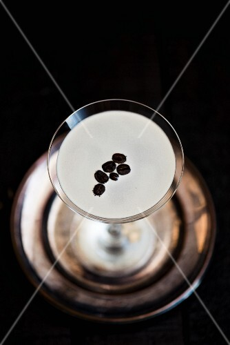 An espresso Martini on a silver plate