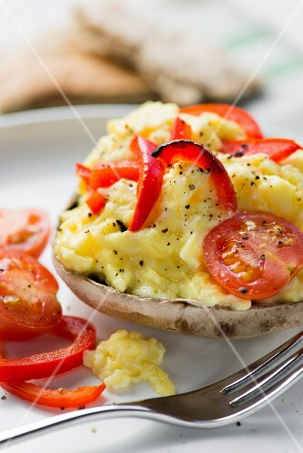 Mushrooms with tomatoes. peppers and scrambled eggs