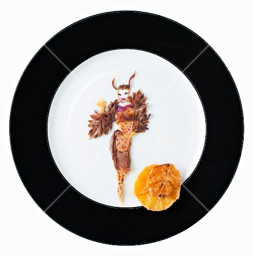 Fashion food: duck meat with oriental spices and mandarins