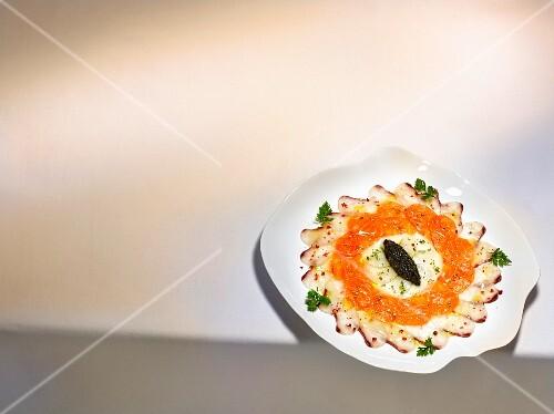 A dish by Harald Wohlfahrt: carpaccio of salmon, branzini and scallops