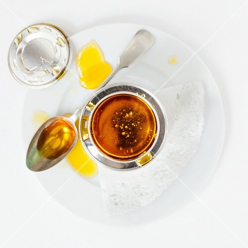 Golden syrup in a pot and on a spoon