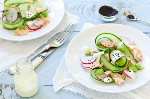 Hot-smoked slamon with edamame and cucumber salad and radishes