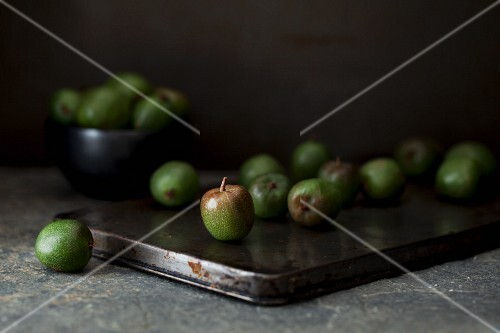 Kiwi berries on a rustic baking tin