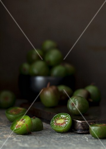 Kiwi berries, whole and halved, on a baking tray