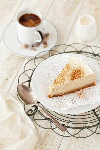 A slice of spiced cheesecake with coffee