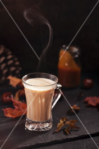 A steaming cup of caramel milk