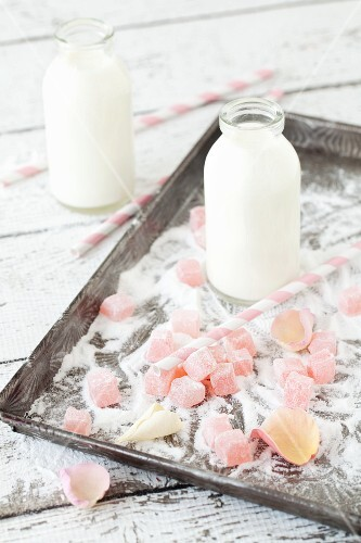 Turkish delight, milk and rose petals on a tray