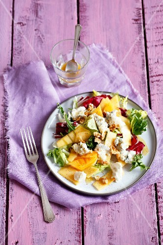 Persimmon salad with gorgonzola, walnuts and a honey and mustard dressing