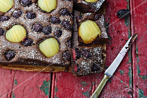 Chocolate and pear cake with blackberries