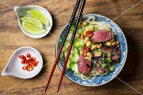 Beef salad with rice noodles, cucumber, peanuts and chillis with a lime dressing (Asia)