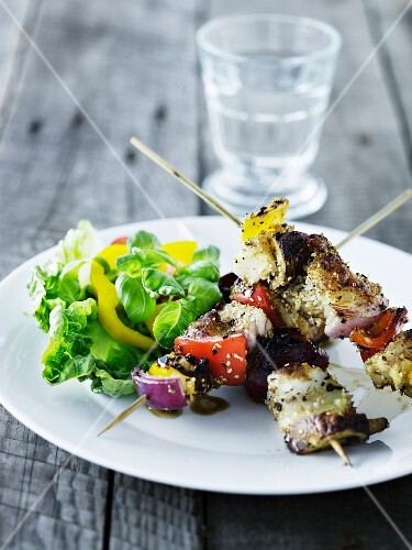Grilled skewers with salad