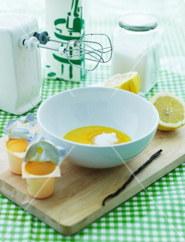 Ingredients for Danish buttermilk dessert: egg yolk, vanilla, sugar and lemons