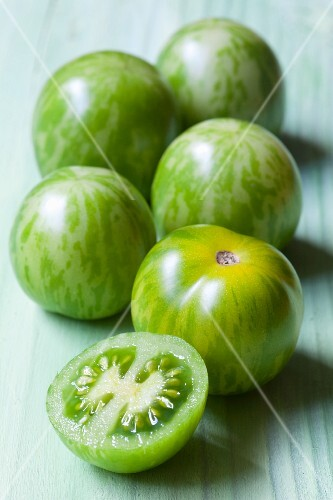 Green tomatoes, whole and halved