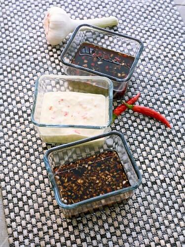 Three different marinades: Indian yoghurt marinade, teriyaki and hoisin