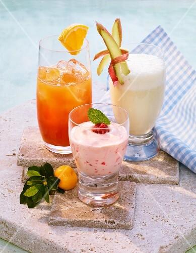 A rhubarb shake, an iced raspberry shake and a spring shake made with orange juice