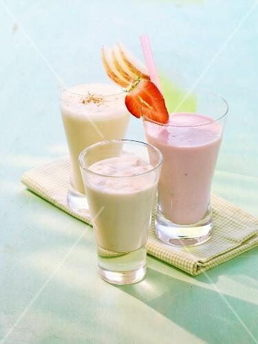 A soya grapefruit drink, a strawberry yoghurt frappe and an apple and vanilla milkshake