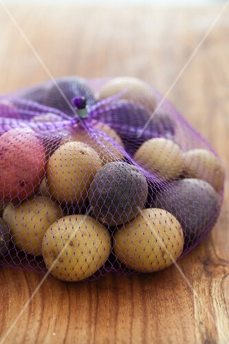 A net of various new potatoes