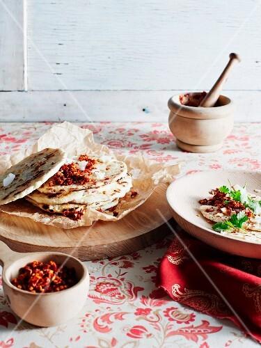 Unleavened bread with a spicy chilli sauce (Sri Lanka)