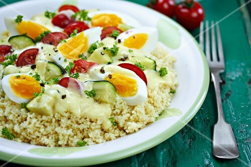 Couscous with an egg and vegetables sauce