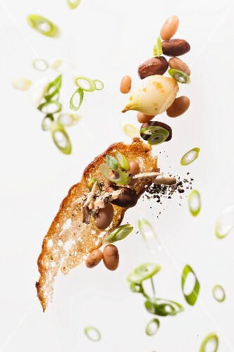 Grilled bread, beans and spring onions