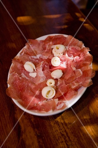 Culatello, sliced, on a plate