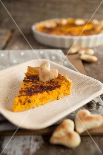Rustic pumpkin tart decorated with pastry hearts