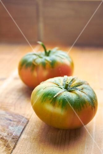 Two freshly washed Heirloom tomatoes