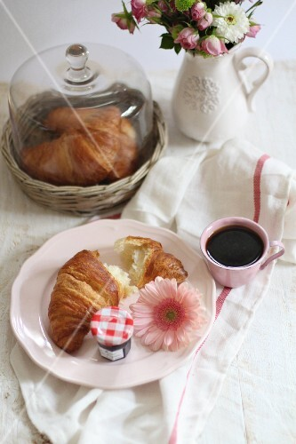 Fresh croissants, jam and coffee