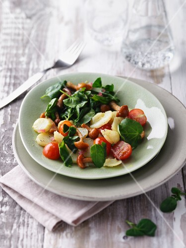Potato and watercress salad with chanterelle mushrooms and cherry tomatoes