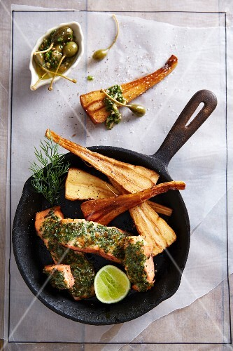 Rainbow trout fillets with a herb crust, parsnips and salsa verde