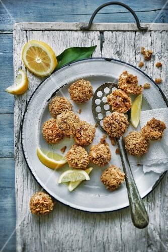Fried lamb meatballs with lemons