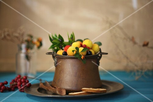 Strawberry tree fruits in an old copper pot