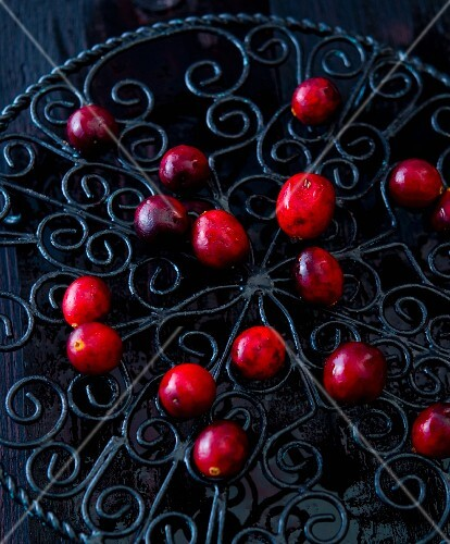 Cranberries on a black cast-iron pot holder