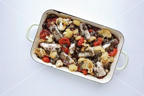 Vegetable bake with quinoa, zander and nutmeg flowers