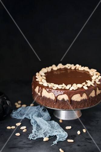 Chocolate cheesecake with caramel, peanuts and ganache