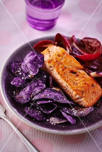 Fried salmon on purple potato chips and a radicchio salad