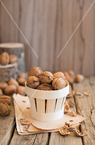 An arrangement of walnuts in a wooden basket