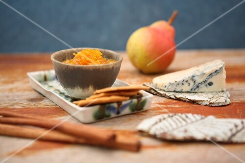 Pear and saffron sauce served with cheese and crackers