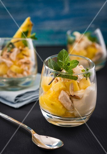 Pineapple desserts with meringue and almonds
