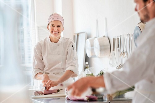 Two chefs working in a commercial kitchen