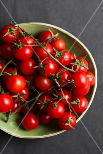Cherry tomatoes on a grey surface