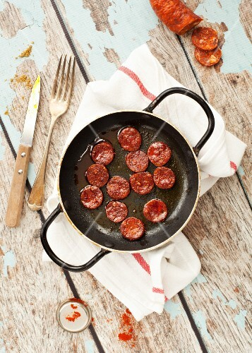 Fried chorizo slices in a pan