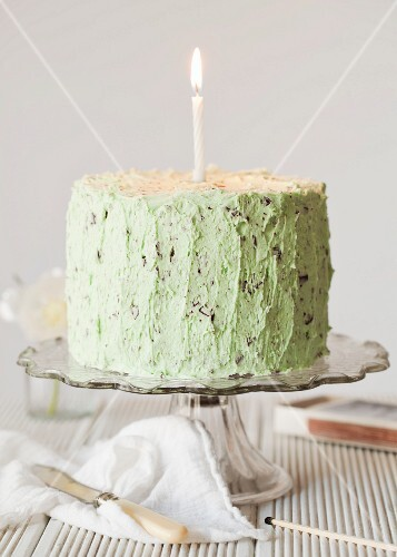 Mint chocolate cake with chocolate chips and a candle