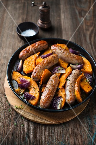 Sausages with pumpkin and onions