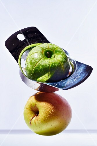 A chopped Granny Smith apple on top of a Golden Delicious apple