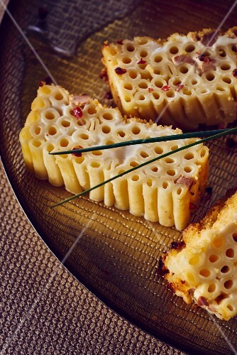 Three portions of macaroni cake