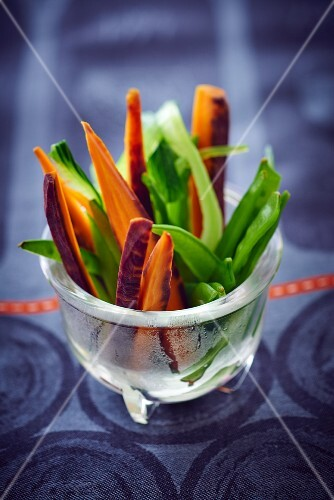 Vegetable sticks and mange tout in a glass