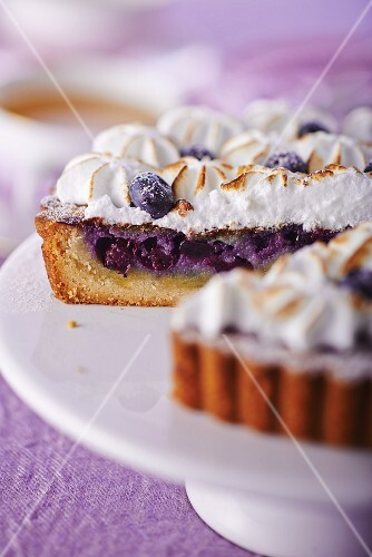 Blueberry tart with meringue, sliced