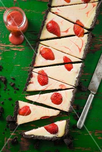 An Oreo chocolate cake with strawberries